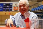 Paul Younes of Kearney reacts to his poker hand at Thursday's Red Dress Poker Tournament. Younes was among more than 150 people playing in the University of Nebraska at Kearney event, which raised about $9,000 for women's heart health. (Photo by Corbey R. Dorsey, UNK Communications)