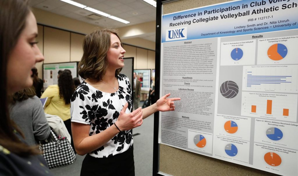 Lindsey Smith, a junior at the University of Nebraska at Kearney, shares the results of her study on club volleyball participation and its connection to collegiate scholarships Wednesday during Student Research Day at UNK. (Photo by Corbey R. Dorsey, UNK Communications)