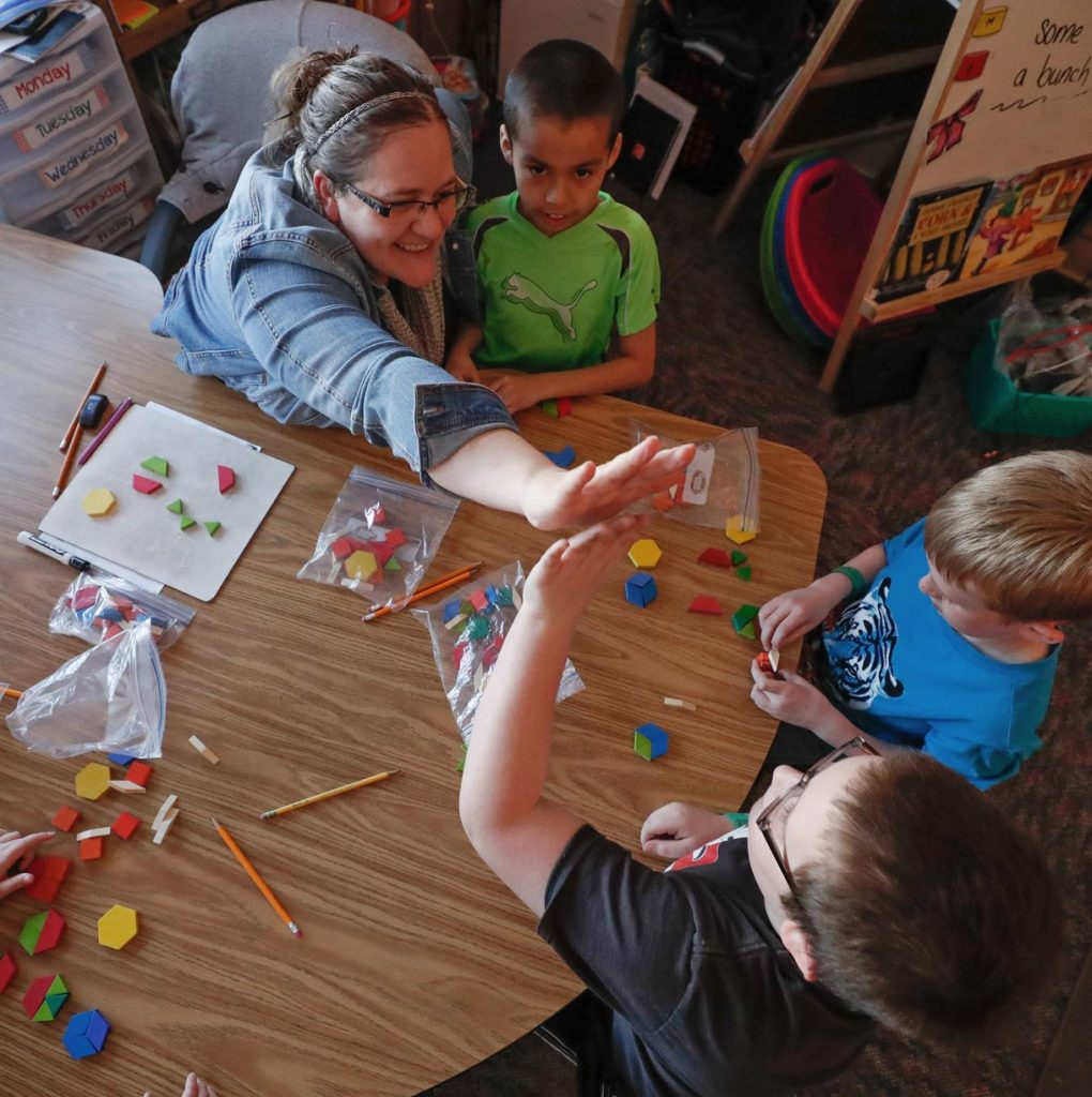 "Bryant Elementary School Principal Mark Johnson says first-grade teacher Michelle Fouts creates a ""fun and family-type atmosphere"" at the Kearney school. Fouts' passion for teaching and commitment to future educators led to her induction into UNK's Academy for Teacher Education Excellence. (Photo by Corbey R. Dorsey, UNK Communications)"