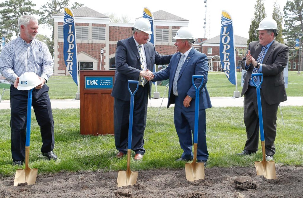 UNK Chancellor Doug Kristensen, left, is congratulated by University of Nebraska Regent Paul Kenney, middle, and Pat Carson of BCDM Architects at Wednesday's groundbreaking ceremony for UNK's new $30 million STEM building. (Photo by Corbey R. Dorsey, UNK Communications)