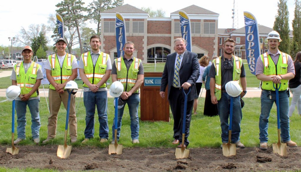 University of Nebraska at Kearney Chancellor Doug Kristensen poses with UNK students currently interning with Hausmann Construction and UNK graduates who work for the Lincoln-based company during a groundbreaking ceremony for the new STEM building on campus. Pictured, from left, are Hausmann interns Kevin Andrade and Joe Meister, project manager Jade Clement, project superintendent Aaron Abramson, Kristensen and project superintendents Jake Wheeler and JD Stone. (Courtesy Photo)