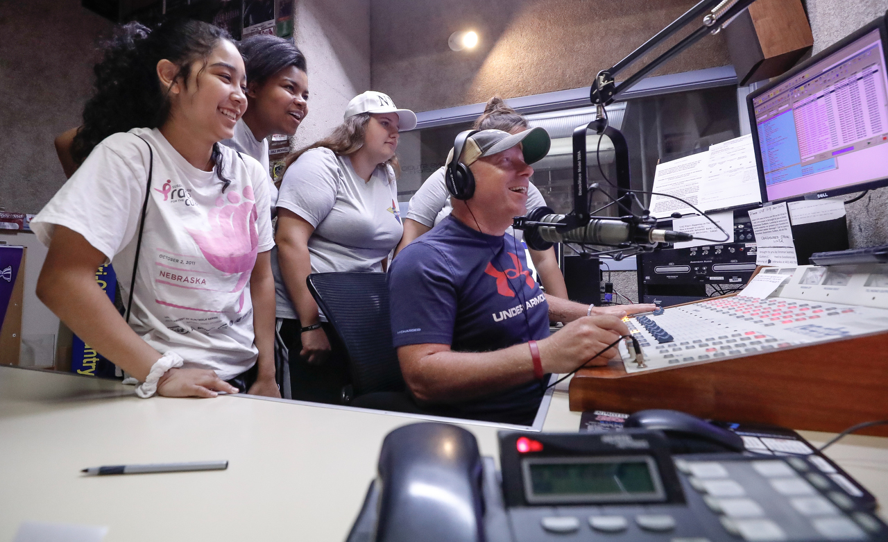 Program director Scott O'Rourke shows Digital Expressions Media Camp participants the Y102 studio during their visit to NRG Media in Kearney.
