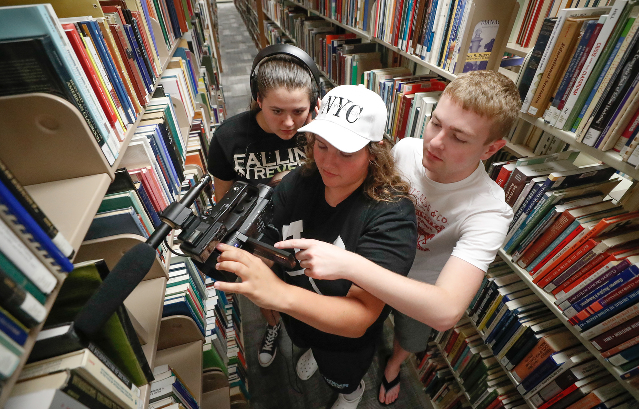 From left, Sammantha O'Connor of Lincoln and Julia Weide of Omaha work with UNK student Cy Cannon during the Digital Expressions Media Camp.
