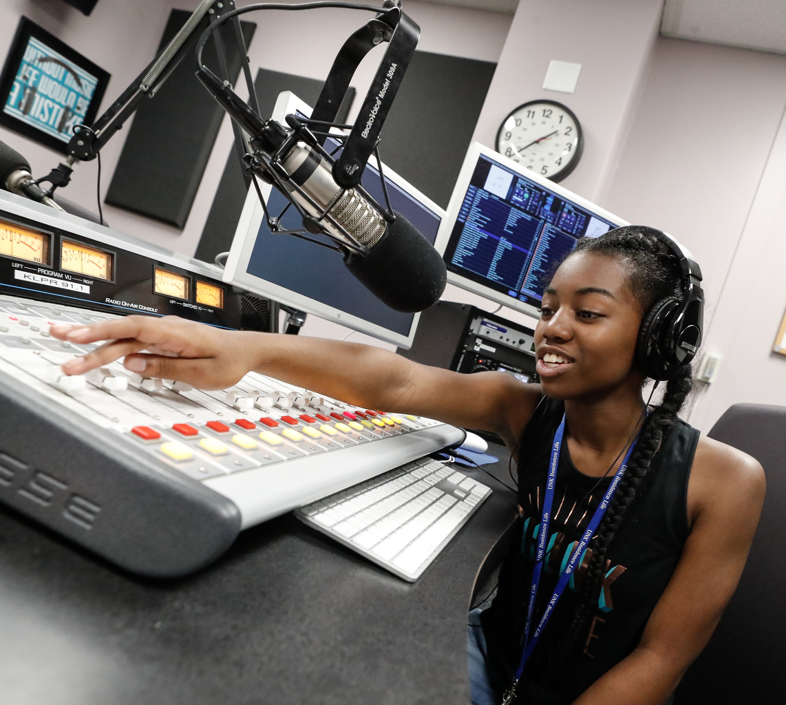 Christina Mayl of Omaha runs the soundboard during a radio broadcast while participating in the Digital Expressions Media Camp hosted by UNK's Department of Communication.