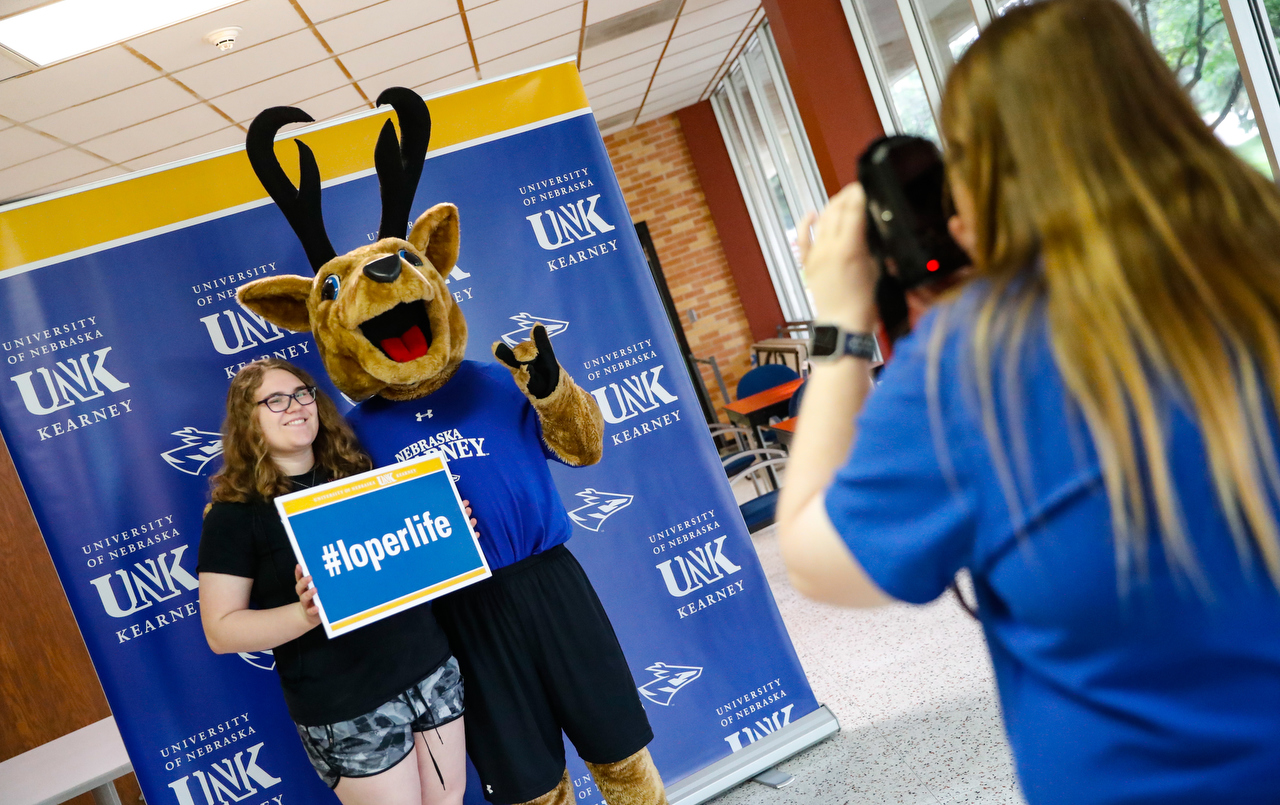 New Student Enrollment is a good time to take the first of many photos with Louie the Loper.