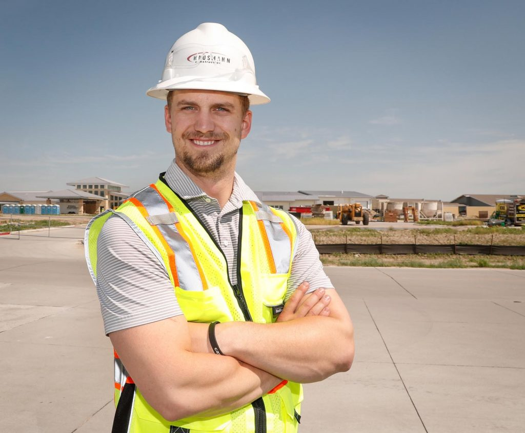 "UNK graduate JD Stone, a project superintendent with Hausmann Construction, is currently working on the Central Nebraska Veterans Home complex in northeast Kearney. Stone says a construction management degree from UNK is a ""gold star"" on resumes. (Photo by Corbey R. Dorsey, UNK Communications)"