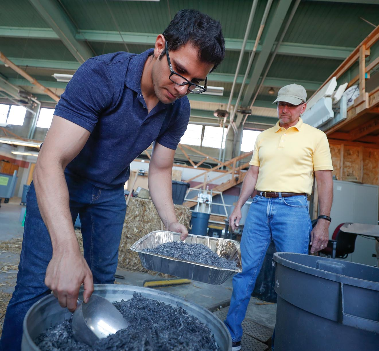 UNK researchers Mahmoud Shakouri, left, and Jim Vaux, both assistant professors of construction management, work on a project that will determine whether corn stover ash can be mixed with cement to improve concrete's durability. (Photo by Corbey R. Dorsey, UNK Communications)