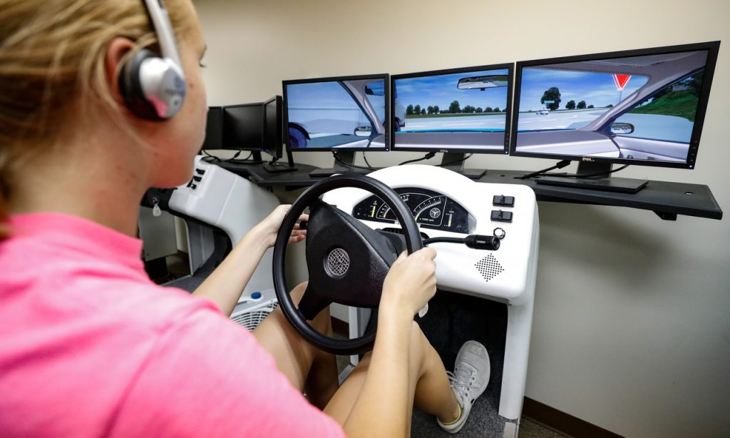 Myra Mommens of Thayer tests her driving skills using a simulator at the Nebraska Safety Center, which is part of the University of Nebraska at Kearney. (Photo by Corbey R. Dorsey, UNK Communications)