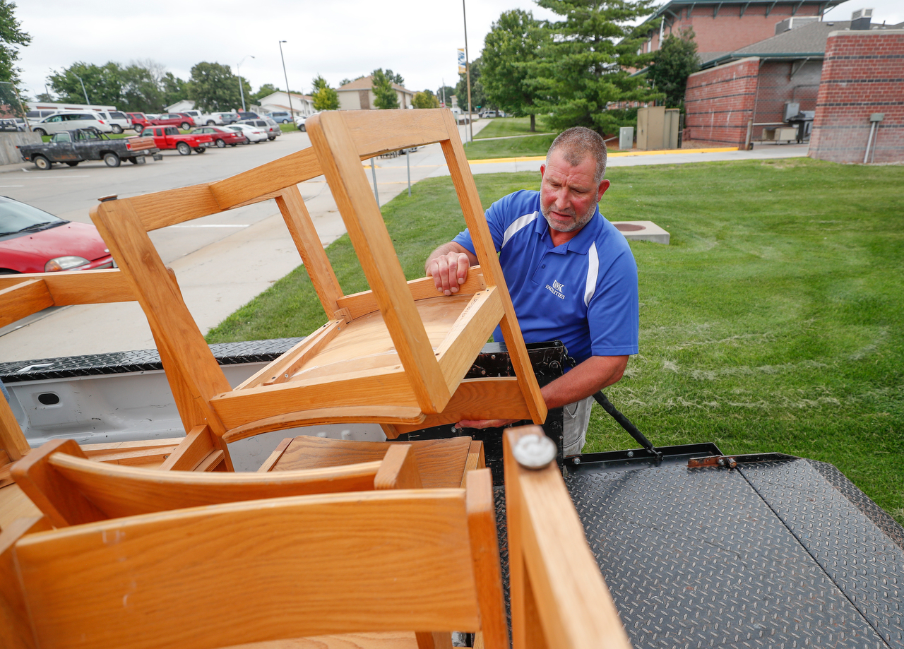Dave White with UNK Facilities Management makes sure the chairs inside a residence hall are replaced with new inventory ahead of the fall semester.