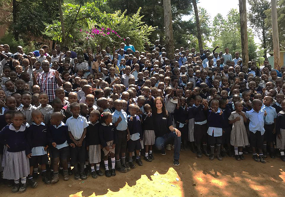 UNK senior Keegan Francl, front middle, gathers with children from the Overcoming Faith school and orphanage in Kenya. Francl, a Grand Island native and president of the Rotaract group at UNK, plans to organize a fundraiser during the upcoming school year to help pay for Kenyan students' education. (Courtesy photo)