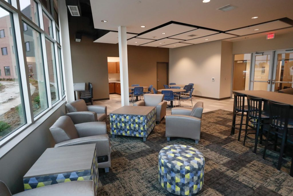 The three-story Village Flats complex includes clubhouse space, on-site laundry facilities, meeting rooms and rooftop patio. (Photo by Corbey R. Dorsey, UNK Communications)