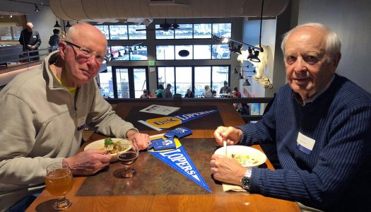 UNK Alumni Patrick Carr, left, and Larry Edwards socialize at a UNK alumni event in Colorado. There are roughly 54,000 UNK graduates living across the globe, with about 70 percent of them residing in Nebraska. In Kearney, approximately 1 in 8 residents has a degree from UNK.