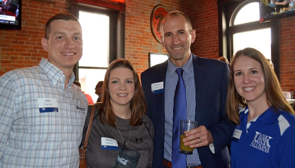 Vice President of Alumni Relations Lucas Dart, third from left, meets with UNK alumni, from left to right, Joey Coachran, Amber Cochran and Angela Davidson at a Kearney Quarterly event at Cunningham's Journal.