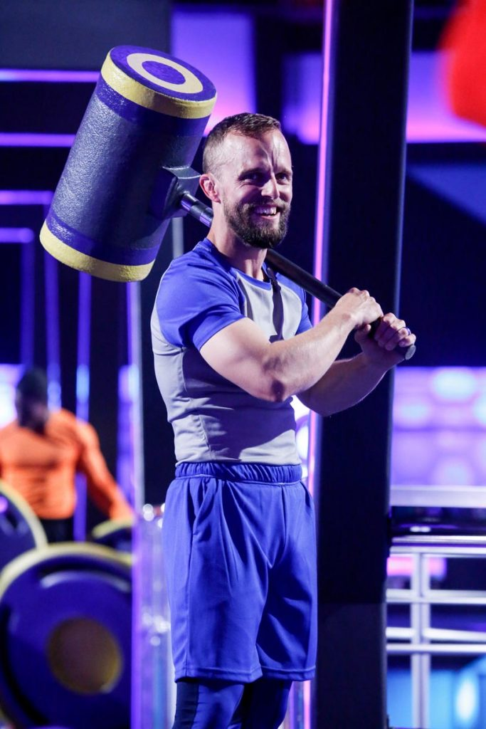 "Bryce Abbey, a professor at University of Nebraska at Kearney, competes in the CBS show ""TKO: Total Knock Out."" Abbey won the episode, which aired Friday, and $50,000. (Photo by Monty Brinton, CBS Broadcasting Inc.)"