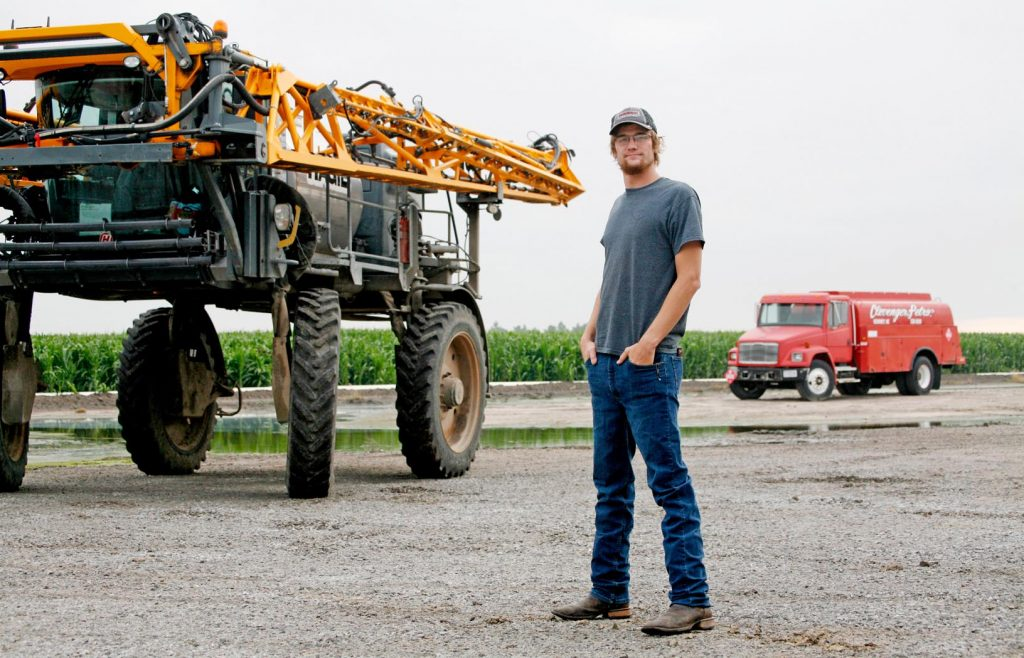 "UNK senior Chance Hersh is ""a little bit of a do-it-all guy"" at Clevenger Farm Products in Gibbon, where he hauls fuel and fertilizer, runs a sprayer, works in the tire shop and repairs equipment. The 21-year-old is studying agribusiness to broaden his future career opportunities. (Photo by Tyler Ellyson, UNK Communications)"