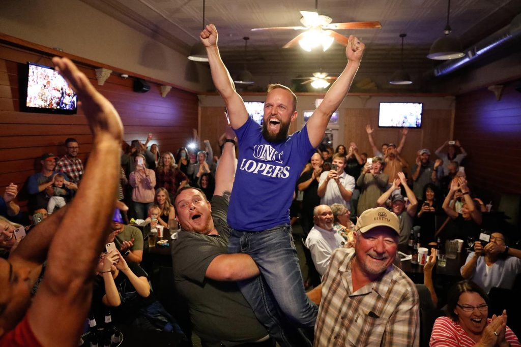 "UNK associate professor Bryce Abbey celebrates his win Friday on the CBS show ""TKO: Total Knock Out."" He beat four other competitors to win $100,000. (Photo by Corbey R. Dorsey, UNK Communications)"