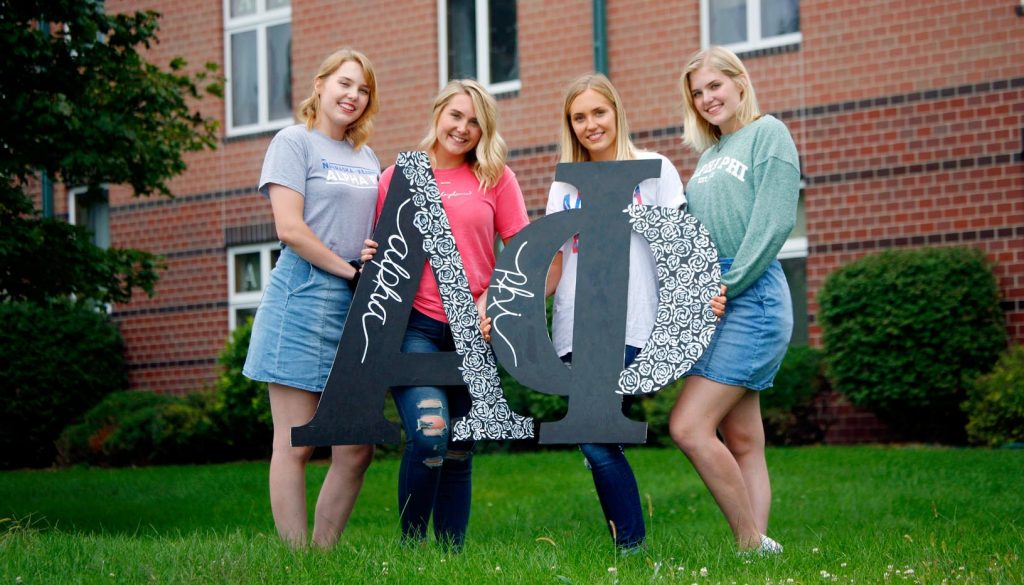 From left, sisters Rebekah, Sarah, Emily and Hannah Petersen are all members of the Alpha Phi sorority at UNK. They also live together in a house their parents purchased. (Photo by Tyler Ellyson, UNK Communications)