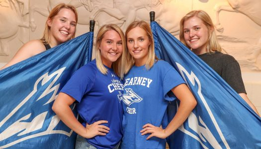 The Petersen sisters are familiar faces around the UNK campus. Sarah and Emily, front row, from left, are members of the UNK Cheer Squad and Rebekah and Hannah, back row, from left, are part of the UNK Pride of the Plains Marching Band Color Guard. (Photo by Corbey R. Dorsey, UNK Communications)