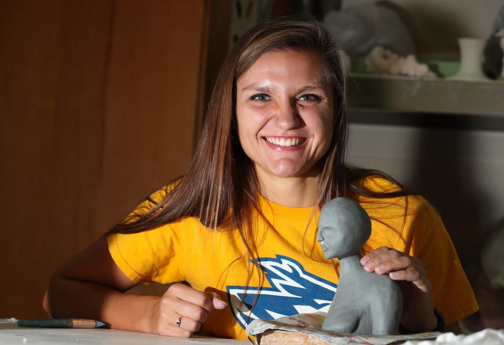"UNK senior Ciera Clark says she's ""two completely different people"" on the soccer field and in the ceramics studio. The studio art major with a ceramics emphasis creates pieces that address body image issues. (Photo by Corbey R. Dorsey, UNK Communications)"