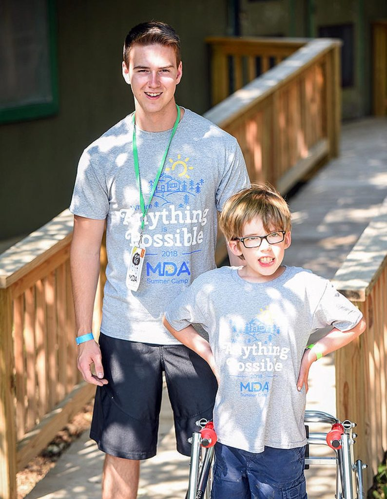 Corey Johnson, left, witnessed muscular dystrophy's impact last summer while serving as a counselor during a weeklong camp organized by the Muscular Dystrophy Association of Nebraska. (Courtesy photo, MDA of Nebraska)
