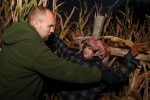 Dryden Downey, left, who manages the actors at KneeKnocker Woods, gets Phi Delta Theta member Jarrett Havens ready for Friday night's frights at the Halloween attraction near Gibbon. Havens, a freshman at UNK, played a scarecrow who suddenly sprang to life as visitors ventured through the haunted cornfield. (Photo by Corbey R. Dorsey, UNK Communications)