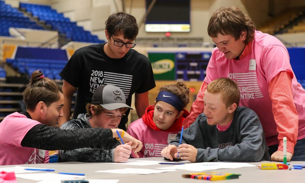 "UNK student Dakota Brodigan of Wood River, back row left, works with area high schoolers Thursday during New Venture Adventure at UNK. ""I've always thought about having my own business, but I never really knew where to start,"" said team member Richard Hecht, front row left, a junior at Lexington High School. ""This is a good way to get an idea of what you have to do."" (Photo by Corbey R. Dorsey, UNK Communications)"