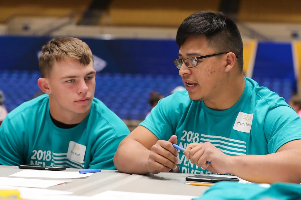 Lexington High School students, from left, Riley Kopf and Harol Molina discuss their business plan for a gym Thursday during New Venture Adventure at UNK. The annual event gives high schoolers a chance to learn about entrepreneurship. (Photo by Corbey R. Dorsey, UNK Communications)