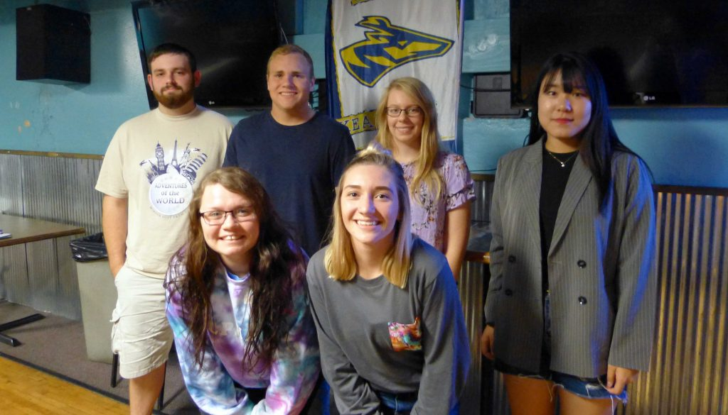 UNK Students in Mass Media members recently inducted include, front row left to right, Cheyanne Diessner and Alana Kellen;  back row left to right, Owen Bridges, Marcus Wagner, Britney Manuel and Yu Jin Oh.
