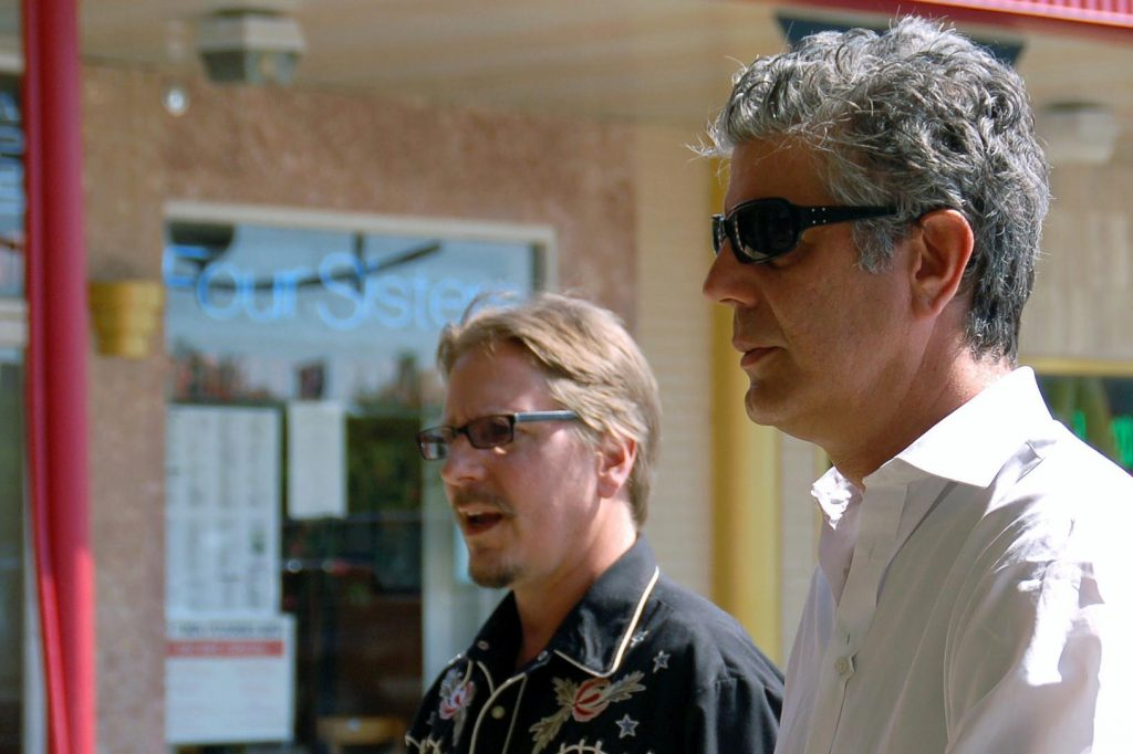 "Washington Post food reporter Tim Carman, left, and host Anthony Bourdain visit the Eden Center in Falls Church, Virginia, while filming an episode of ""No Reservations"" in 2008. (Photo courtesy of Alan Frank)"