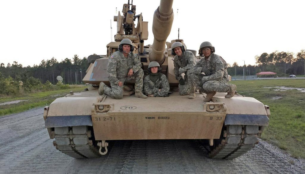 U.S. Army veteran Jason Baker, left, is pictured with members of his armored tank crew at Fort Stewart, Georgia, in 2014. Baker was a tank commander and sergeant with the Army. (Courtesy photo)