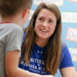 UNK swimmer Mikara Feit, a junior from Lincoln, reads with a kindergartner during a recent visit to Kenwood Elementary School in Kearney. The UNK swimming and diving team is partnering with Kenwood Elementary through the new Loper AthLEADS program. (Photo by Corbey R. Dorsey, UNK Communications)
