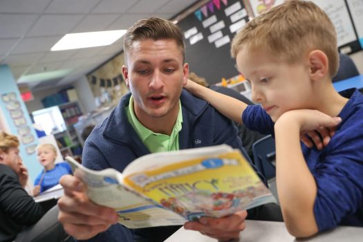 UNK wrestling, swim teams bond with elementary reading buddies as part of Loper AthLEADS program