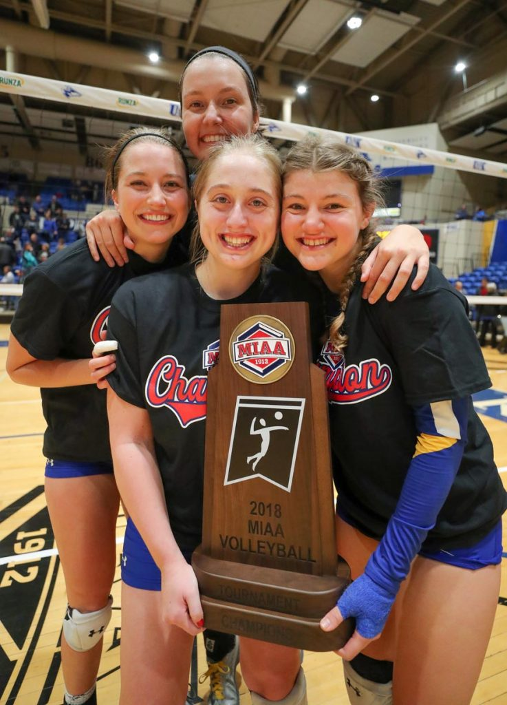 UNK seniors, front row from left, Morgan Stute and Ellie McDonnell and, back row, Lindsey Smith and Kendall Schroer are 130-15 during their collegiate volleyball careers with three MIAA regular-season and conference tournament titles. They've qualified for the NCAA Division II tournament all four years. (Photo by Corbey R. Dorsey, UNK Communications)