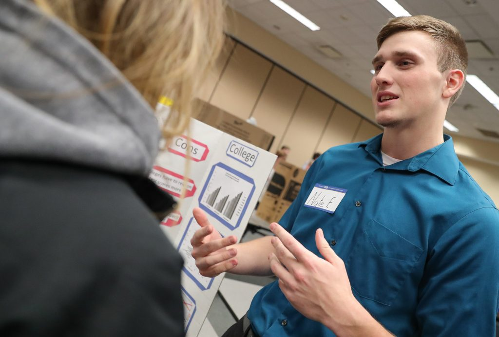 UNK freshman Nate Fields of Elm Creek discusses his University Foundations research project on grade inflation with Emily Serr of Dannebrog during an event Monday in the Nebraskan Student Union Ponderosa Room. (Photo by Corbey R. Dorsey, UNK Communications)