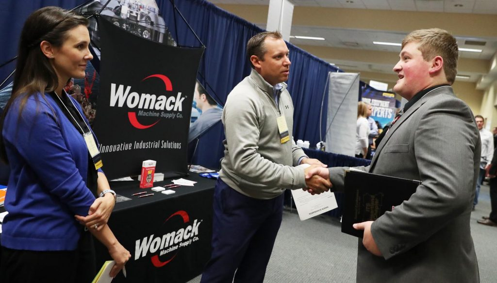 UNK industrial distribution student Haden Scherbarth meets with Womack Machine Supply Co. officials at a career fair on campus. The UNK program has a job placement rate near 100 percent. (Photo by Corbey R. Dorsey, UNK Communications)