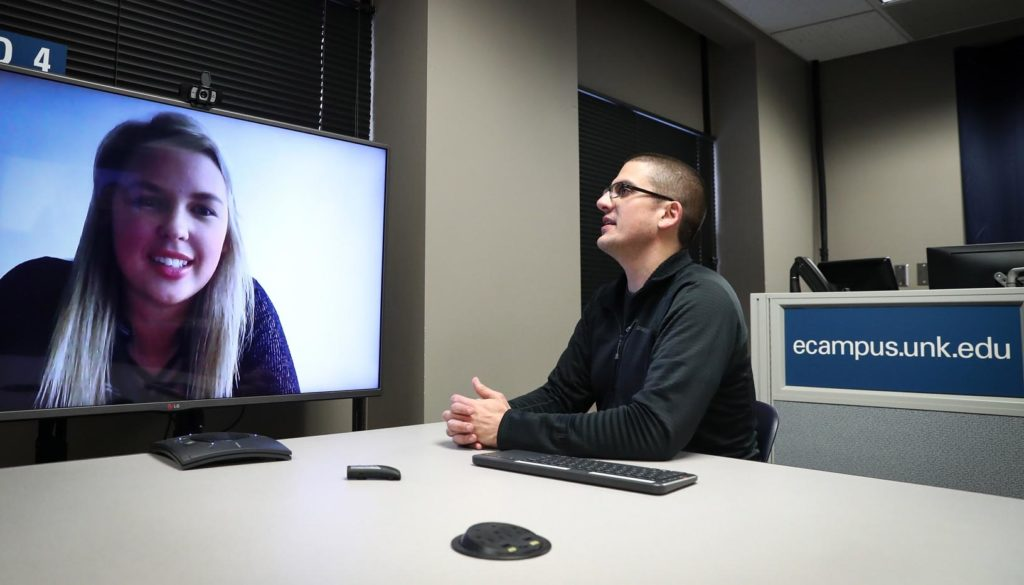 UNK student Shelby Henne of Broken Bow connects remotely with assistant history professor David Vail using technology that enhances UNK's distance-learning courses. Teleconferencing, online discussion forums and video sharing make it easier for students to take classes through UNK, even if they're not on campus. (Photo by Corbey R. Dorsey, UNK Communications)
