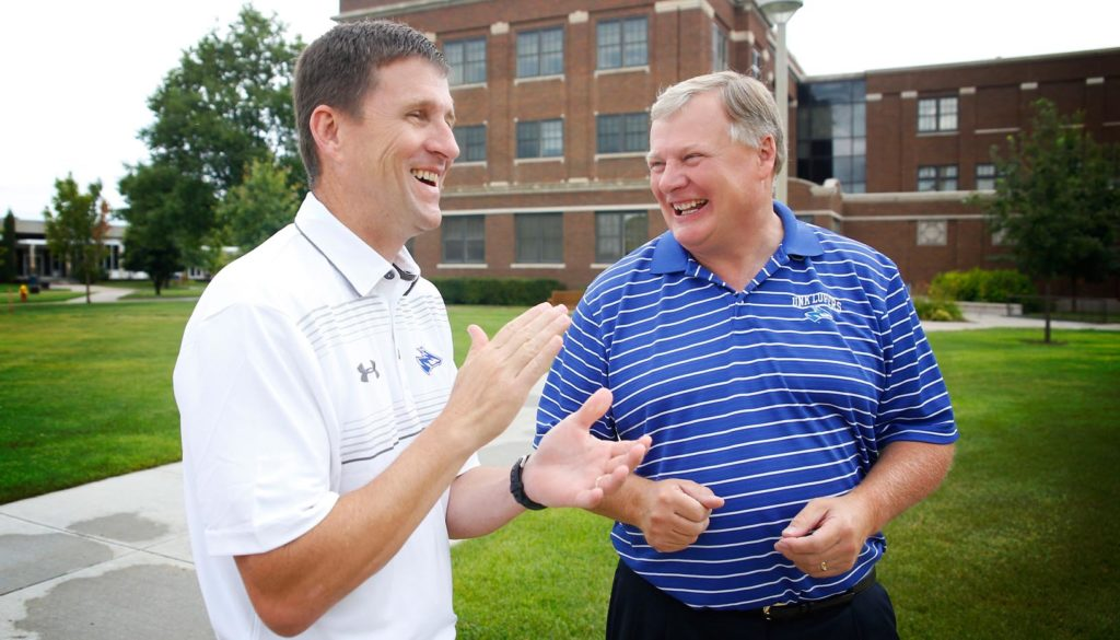 """University of Nebraska President Hank Bounds, left, and UNK Chancellor Doug Kristensen share a light moment while touring the Kearney campus. """"I know of no other president who's been as committed to our students and to Kearney as Hank. This is a big loss for us and our community,"""" Kristensen said Monday following Bounds decision to leave the university. (Photo by Corbey R. Dorsey, UNK Communications)"""