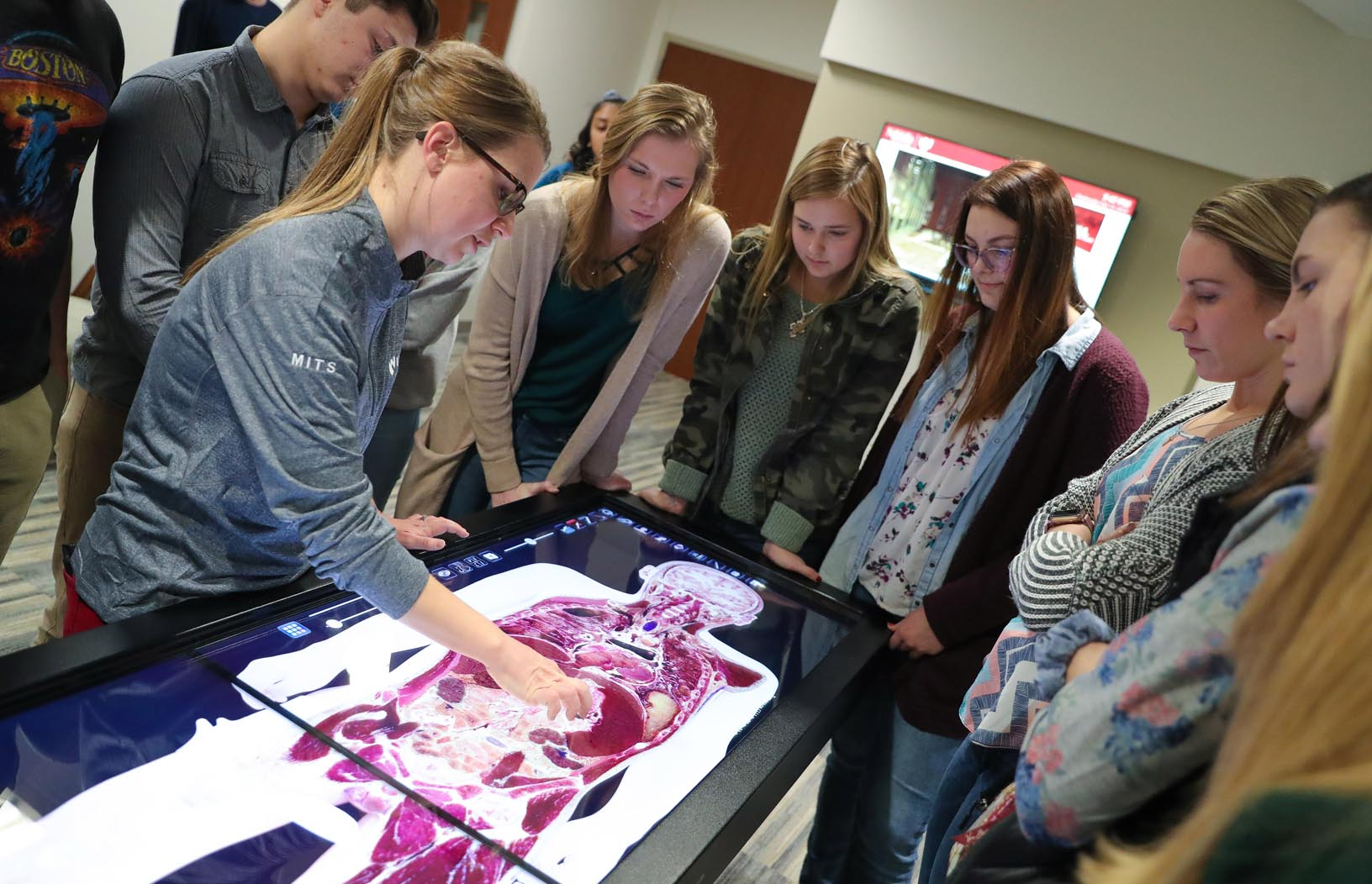 High school students view a demonstration of the Anatomage Table inside the University of Nebraska Medical Center's Health Science Ed Complex at UNK. (Photo by Corbey R. Dorsey, UNK Communications)