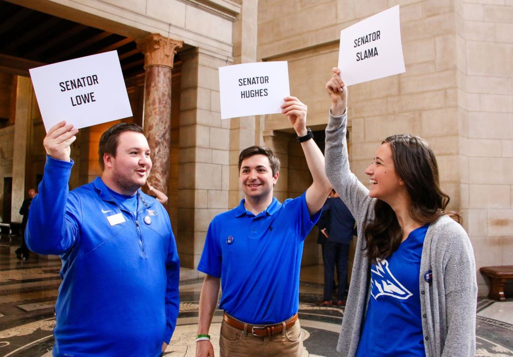 """From left, UNK students Taylor and Trey Janicek of Bridgeport and Nicole Kent of Benkelman wait for state senators to enter the Capitol Rotunda during """"I Love NU Advocacy Day"""" in Lincoln. Wednesday's event gave University of Nebraska supporters an opportunity to meet with lawmakers, share their stories and discuss the university system's impact on the state. (Photo by Amanda Andresen, UNK Communications)"""