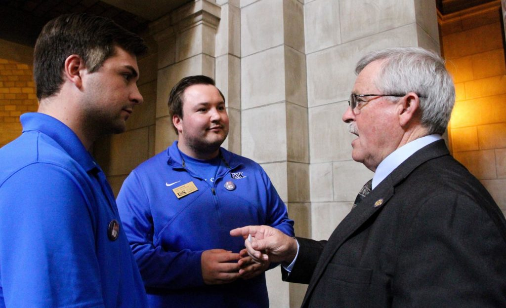 """From left, UNK students Trey and Taylor Janicek of Bridgeport meet with state Sen. Steve Erdman during """"I Love NU Advocacy Day"""" at the Capitol in Lincoln. University of Nebraska students, faculty, staff, alumni and supporters attended Wednesday's event. (Photo by Tyler Ellyson, UNK Communications)"""