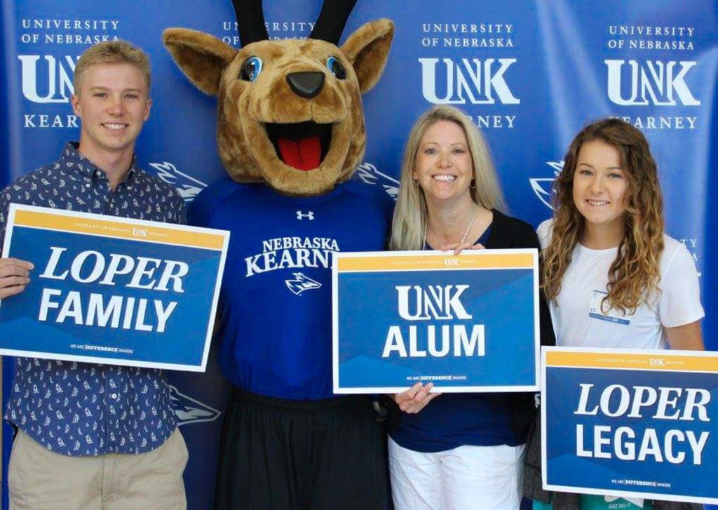UNK alumna Heather Daubert, second from right, poses for a photo with her twin children Trevor and Morgan during UNK's New Student Enrollment in 2017. Heather's parents, Les and Kathy Livingston, both graduated from UNK, where Kathy worked for 38 years, and her grandfather, Les Livingston Sr., was a longtime faculty member and coach at the school. (Courtesy photo)
