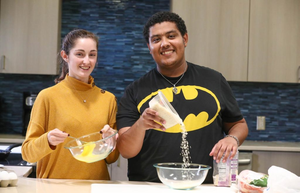 UNK students Blanca Gil of Spain, left, and Jahad Al Bulushi of Oman are preparing popular dishes from their home countries to serve at the Scott D. Morris International Food and Cultural Festival. The event, scheduled for Sunday (March 10) at UNK's Health and Sports Center, will feature cuisine from nine different countries. (Photo by Corbey R. Dorsey, UNK Communications)