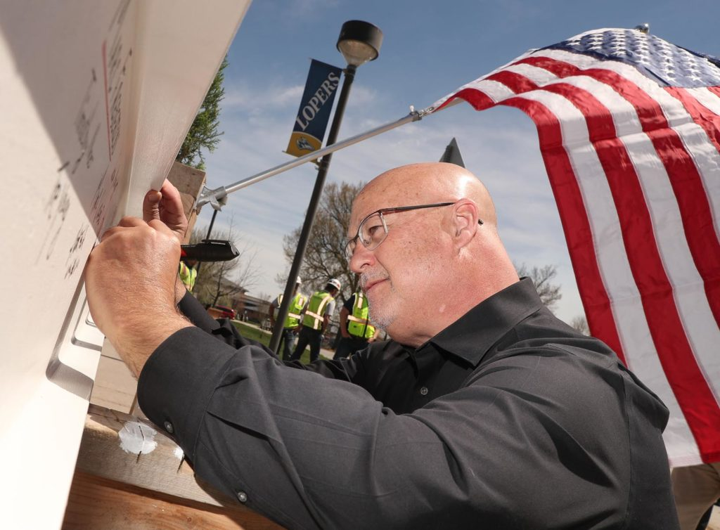 Tim Burkink, dean of UNK's College of Business and Technology, participates in a ceremonial beam signing and topping-out event for the university's new STEM building. Tuesday's event celebrated the continued progress on the 90,000-square-foot facility, which is scheduled for completion in spring 2020. (Photo by Corbey R. Dorsey, UNK Communications)