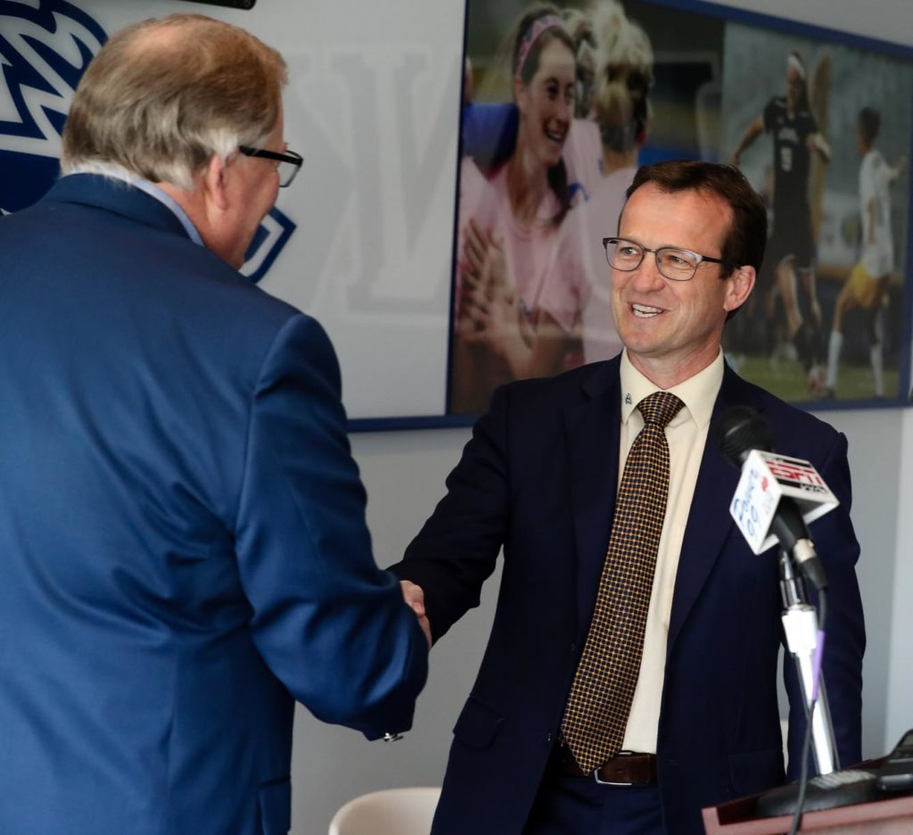 UNK Chancellor Doug Kristensen, left, congratulates Marc Bauer at Tuesday's news conference after announcing Bauer as the new athletic director for the Lopers. (Photo by Corbey R. Dorsey, UNK Communications)