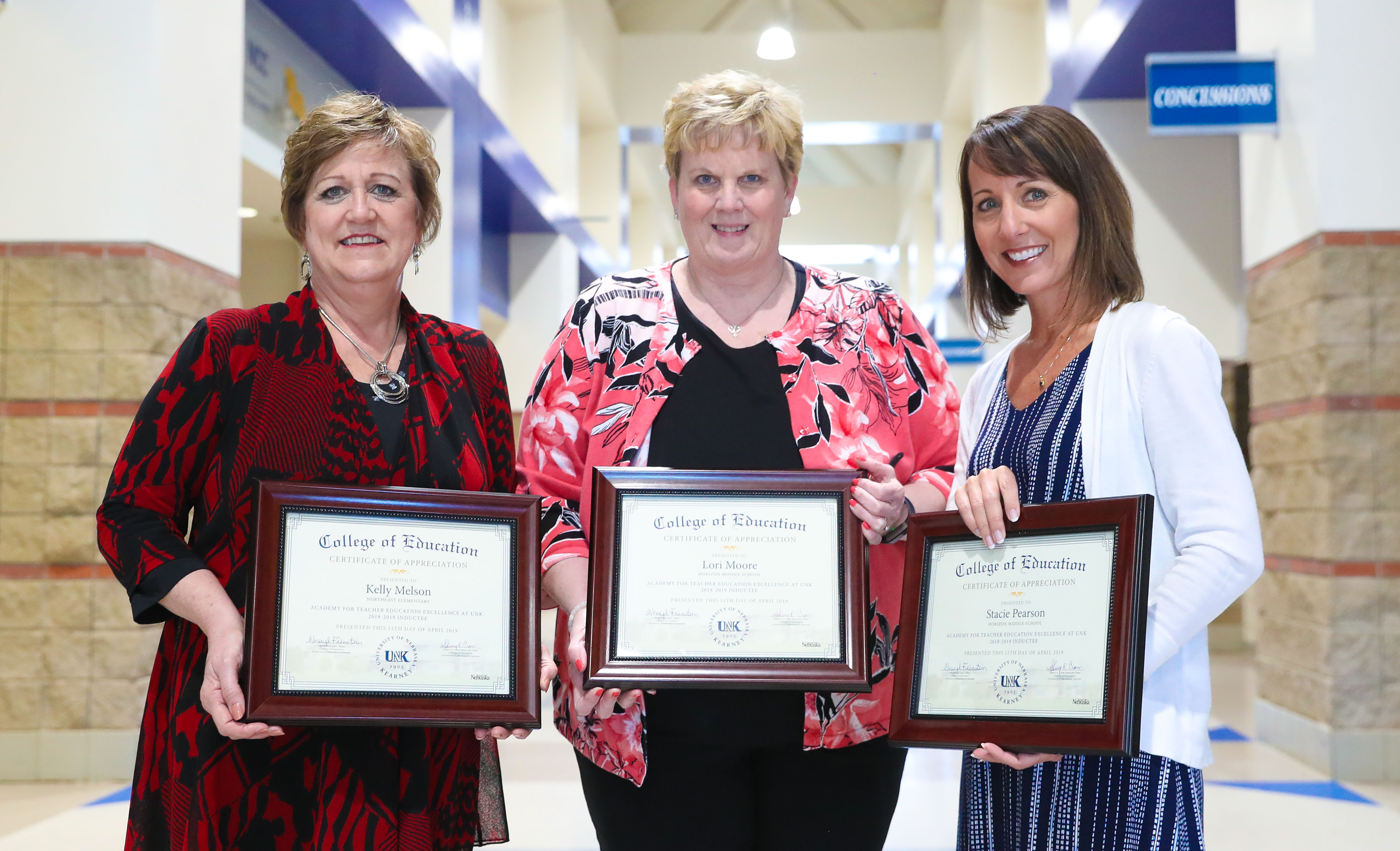 Kearney Public Schools educators, from left, Kelly Melson, Lori Moore and Stacie Pearson are the 2019 inductees into UNK's Academy for Teacher Education Excellence. They were recognized Wednesday during a ceremony on the UNK campus. (Photo by Corbey R. Dorsey, UNK Communications)