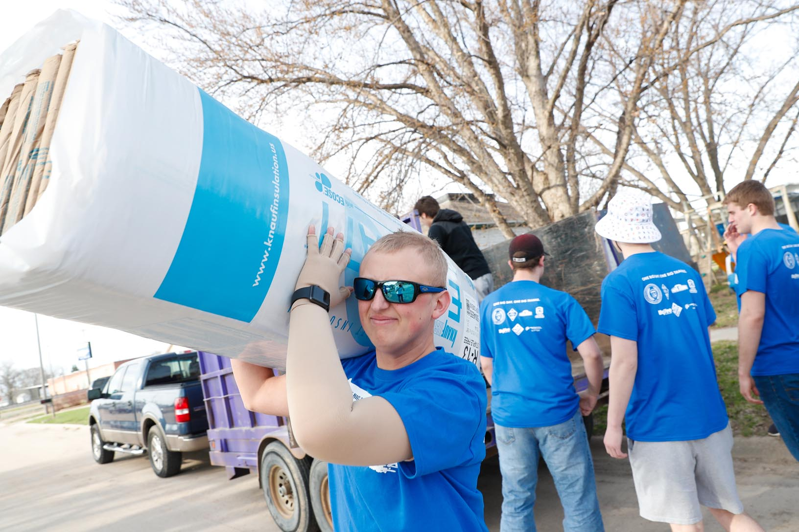 UNK student Kyle Anderson, a Sigma Tau Gamma fraternity member, helps with flood recovery efforts in Gibbon Saturday. Anderson is from Columbus, which also was damaged in the recent floods. (Photo by Corbey R. Dorsey, UNK Communications)