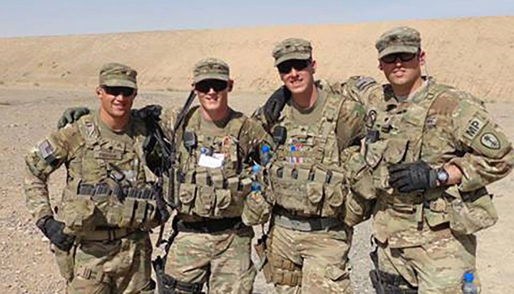 UNK student Jerromy Cissell, second from left, is pictured with his military police team during a deployment to southern Afghanistan. Cissell, who graduates from UNK next week, put his education on hold twice for yearlong deployments as a U.S. Army Reserve member. (Courtesy photo)