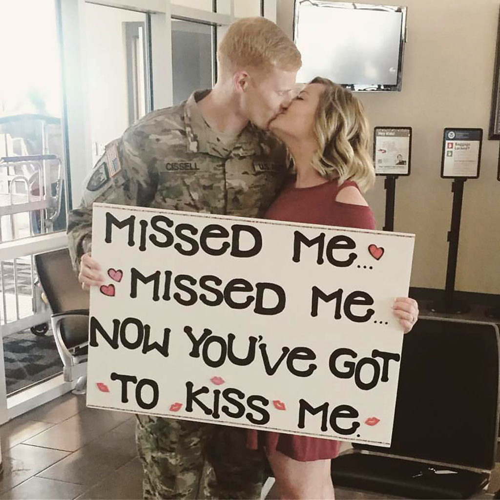 Jerromy Cissell is greeted at Kearney Regional Airport by his wife Blair after returning from his second deployment to Afghanistan in 2016. Cissell has served in the U.S. Army Reserve and National Guard for 10 years. (Courtesy photo)