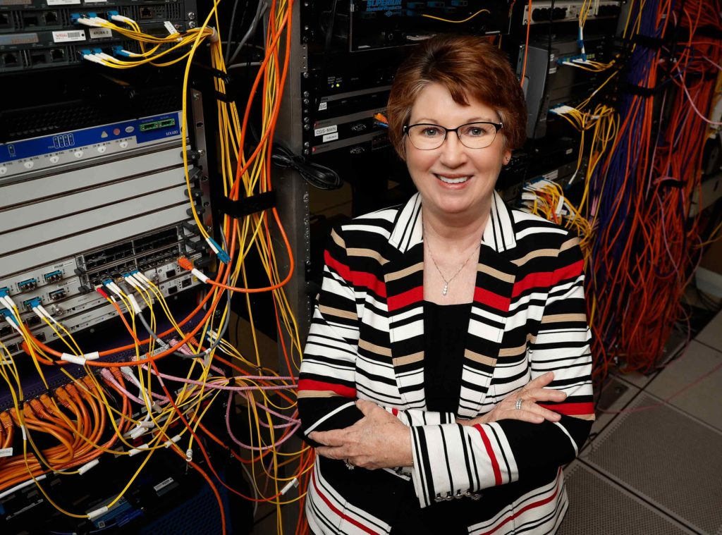 During her 41-year career at UNK, Deb Schroeder was part of projects that developed the campus network, introduced wireless internet and transitioned the student information system from punched cards to computer terminals and online databases. (Photo by Corbey R. Dorsey, UNK Communications)