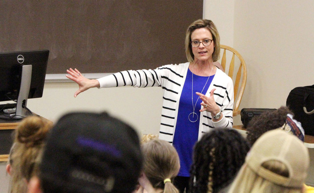 Kiphany Hof, associate director of UNK Counseling and the Women's Center, leads last week's active bystander training for UNK student-athletes. The training focused on alcohol abuse, mental health and sexual assault. (Photo by Tyler Ellyson, UNK Communications)